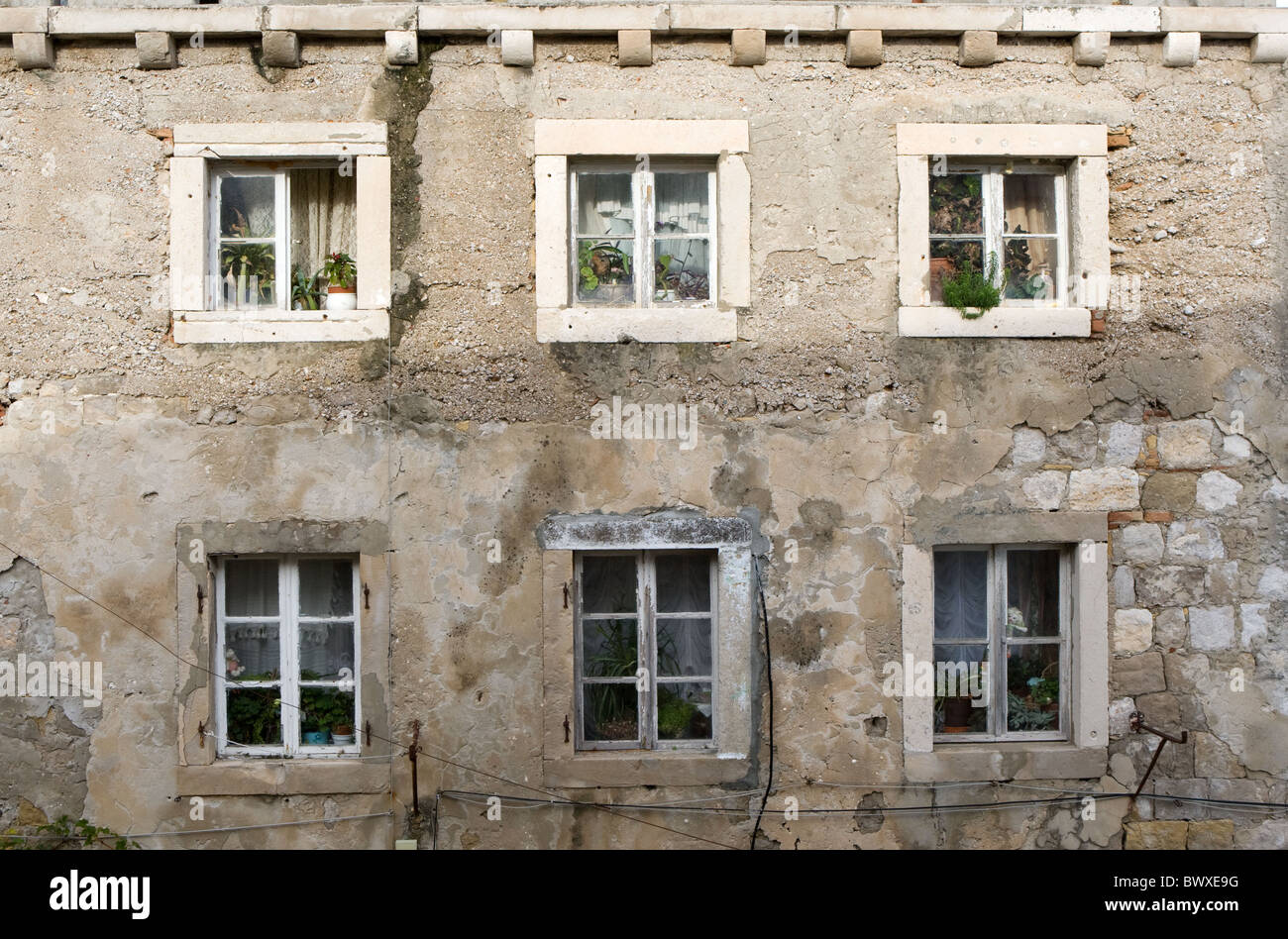Six windows in the side of a building in Dubrovnik Old Town Stock Photo