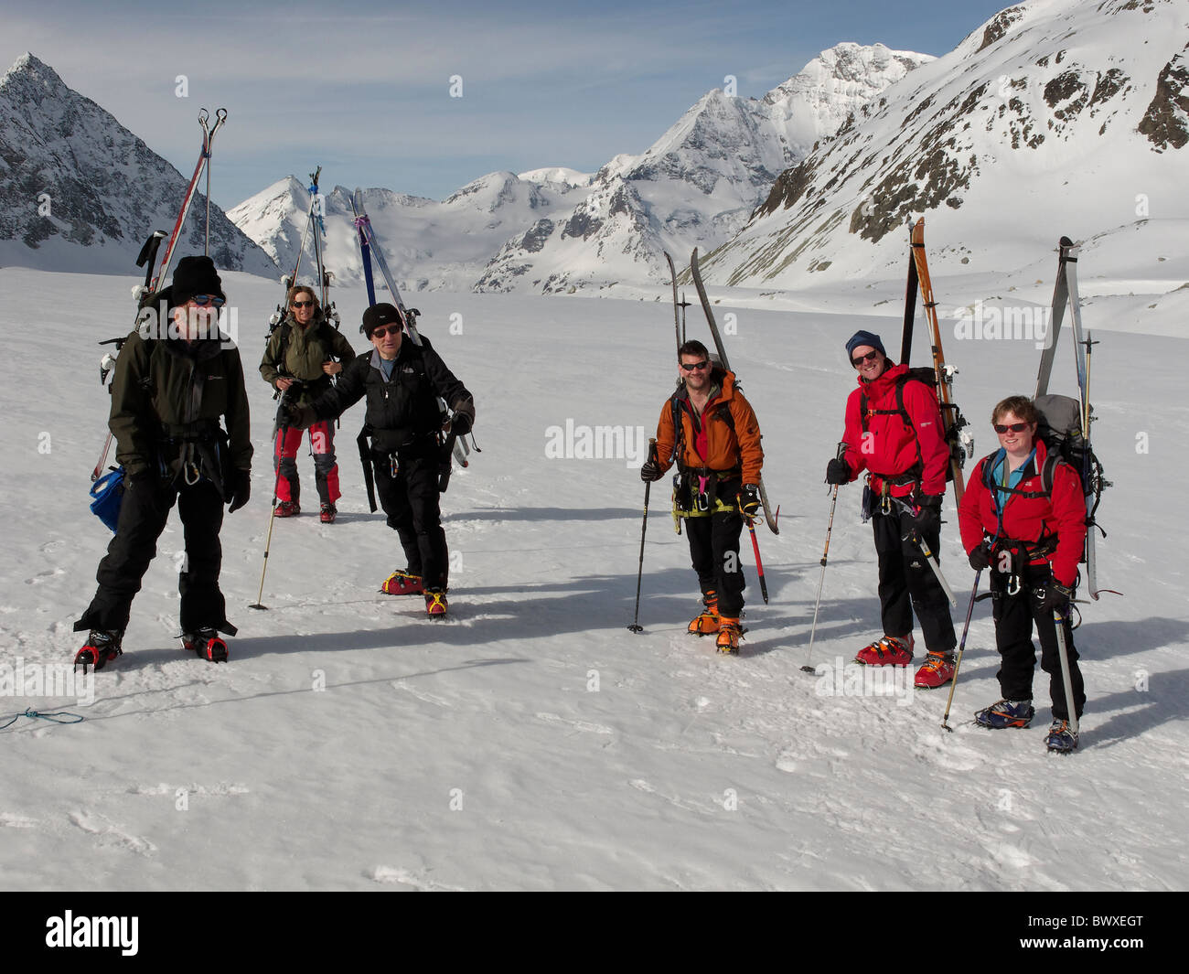 A group of ski tourers, ready to walk up the steeper section at the side of the Brenay icefall, on the Brenay Glacier, - Stock Image