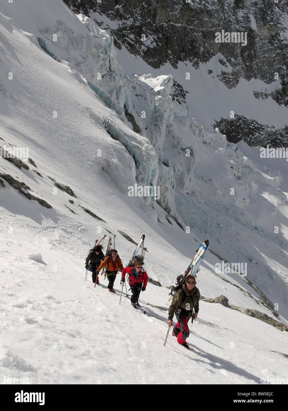 A group of ski tourers, walking up the steeper section at the side of the Brenay icefall, on the Brenay Glacier, - Stock Image