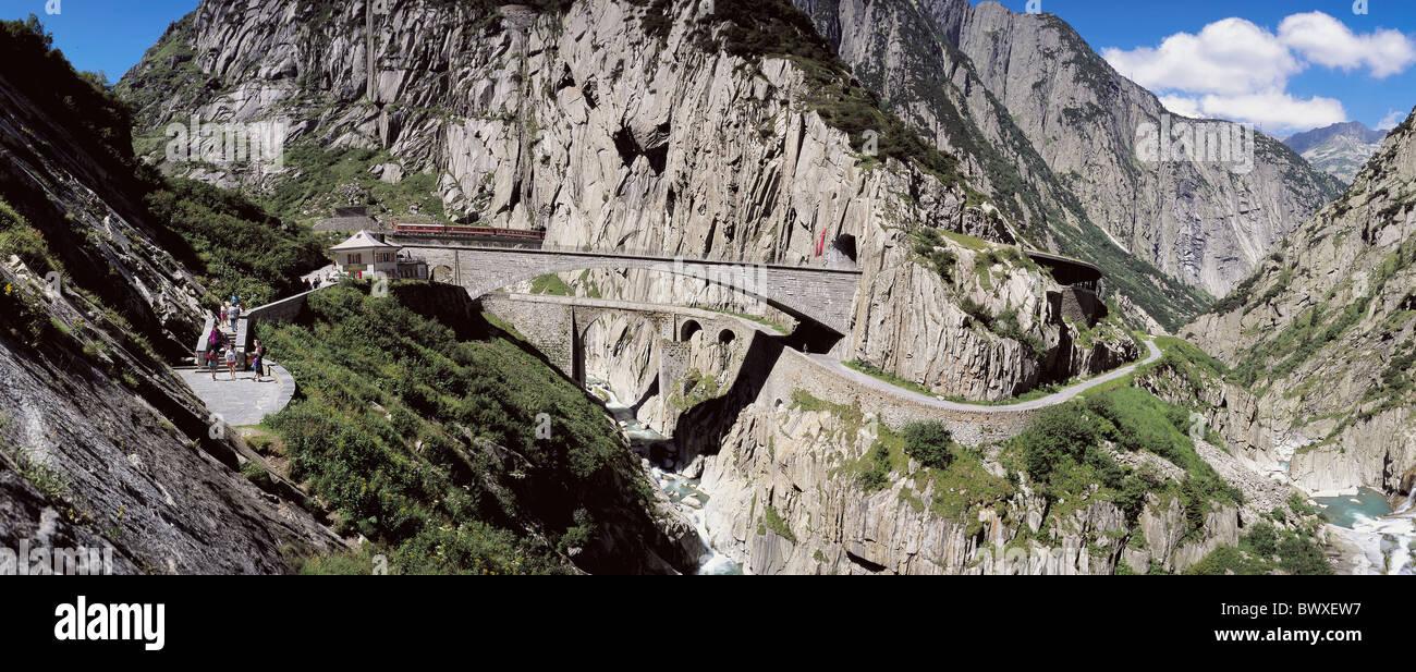 canton Uri Schollenenschlucht Gotthard Switzerland Europe bridges river flow railway inn tourist mountains - Stock Image