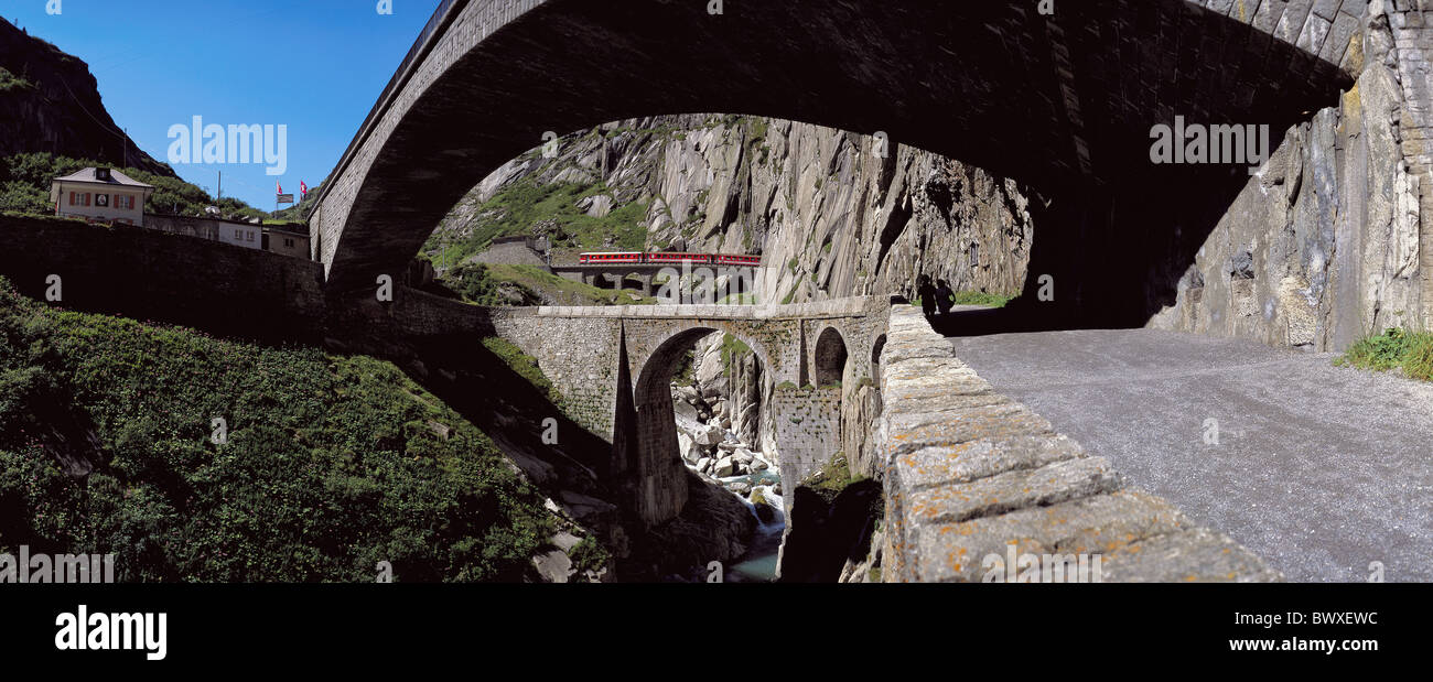 railway bridges river flow footpath inn Gotthard Switzerland Europe Schollenenschlucht Switzerland Europe - Stock Image