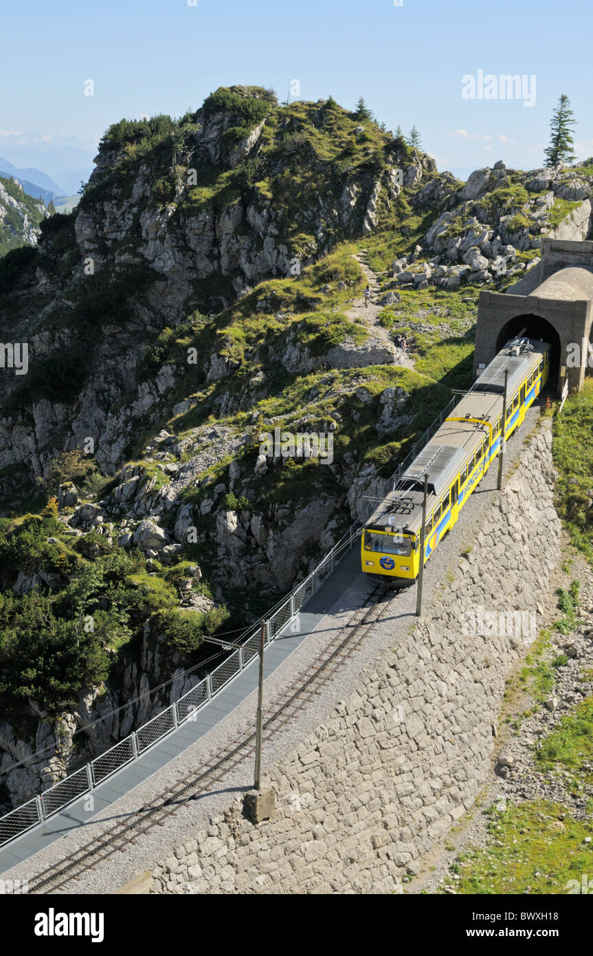 Downhill going train of the Wendelstein cog railroad just under the summit station, Bavarian alps, Germany - Stock Image