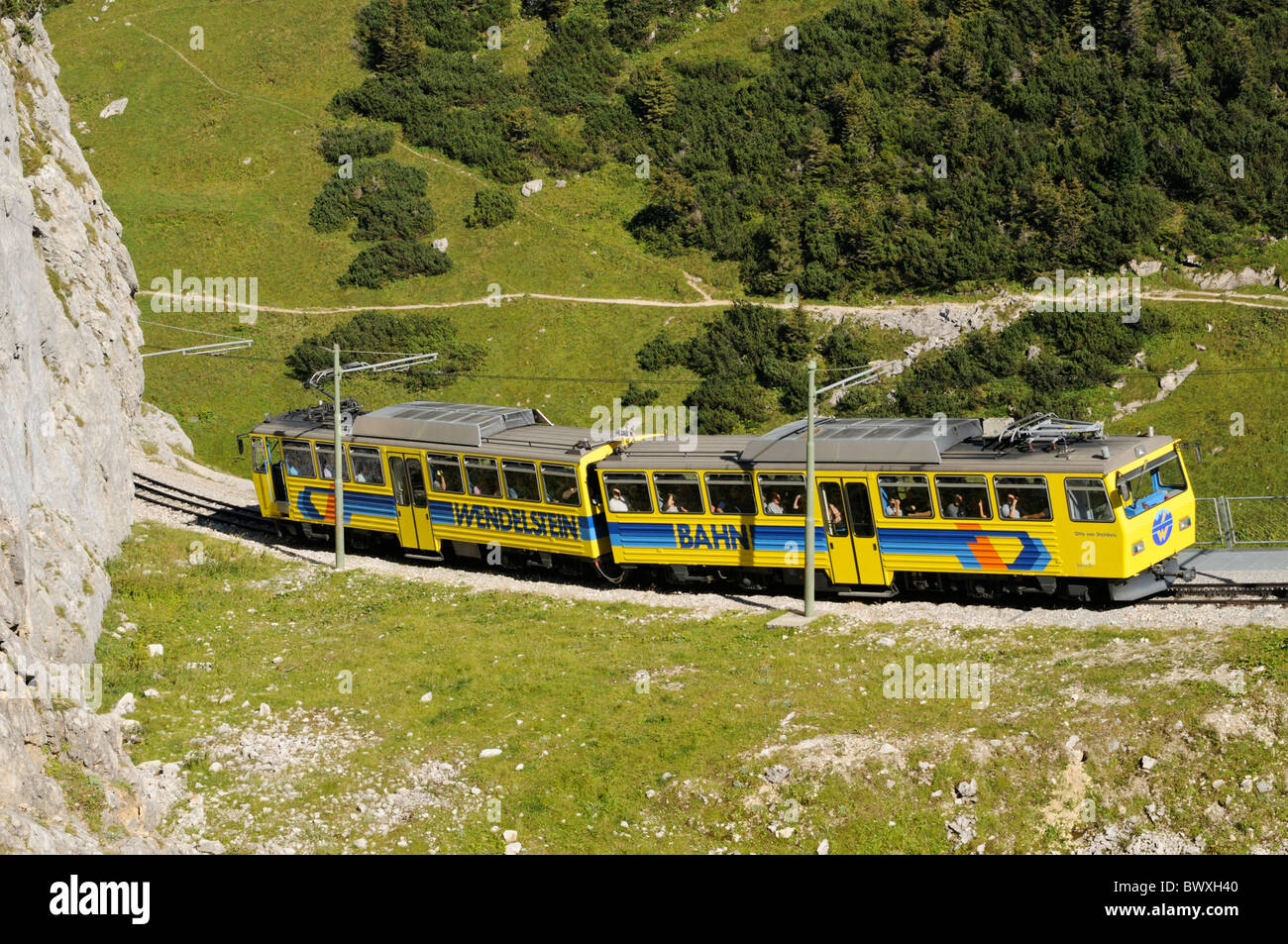 Downhill going train of the Wendelstein cog railroad shortly after the summit station, Bavarian alps, Germany - Stock Image