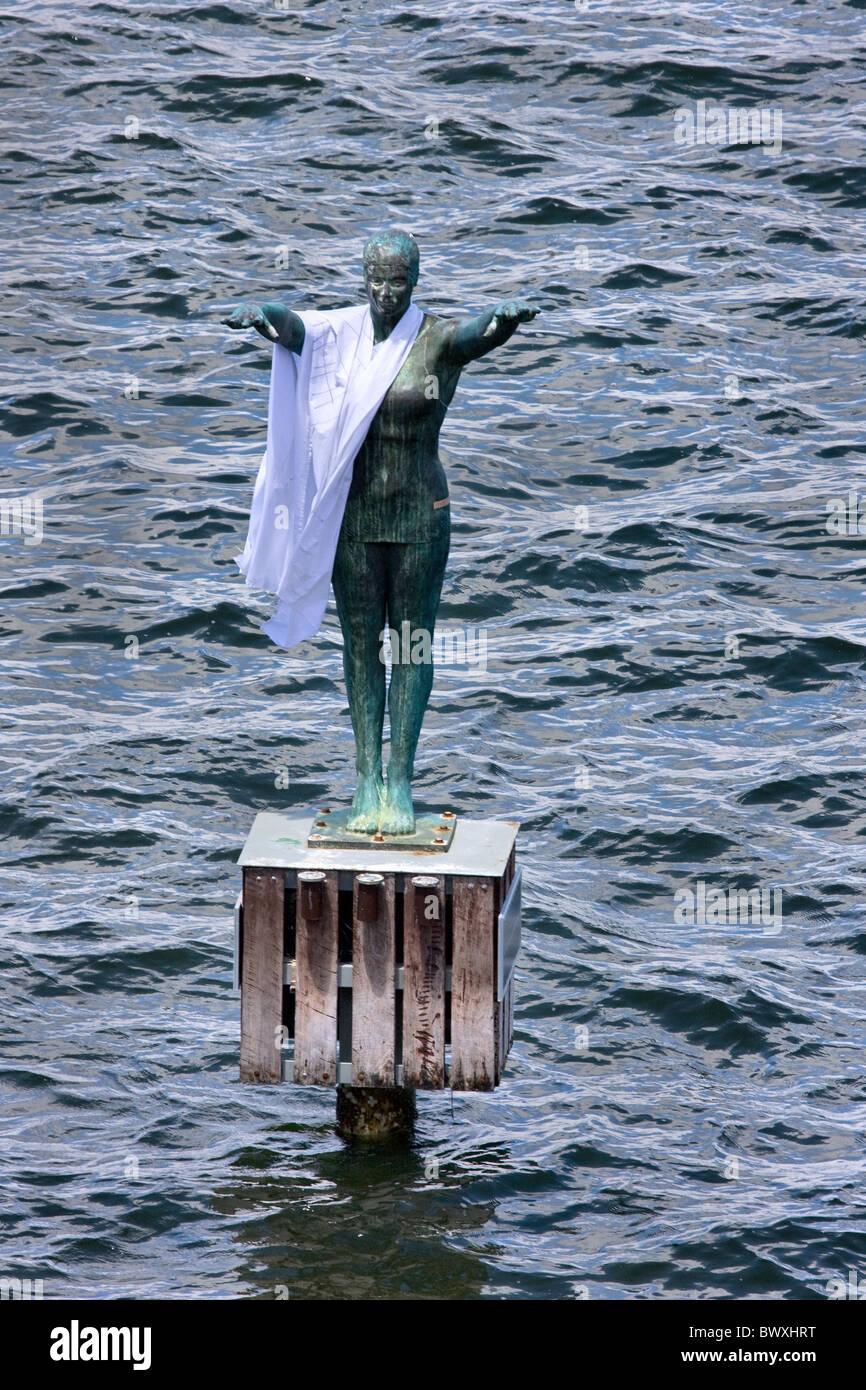 Bronze sculpture of a bather near Crawley boathouse on the Swan river estuary in Perth Western Australia with toga - Stock Image