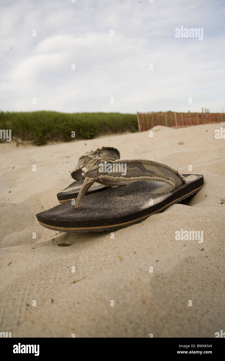 flip flops in sand on beach - Stock Image