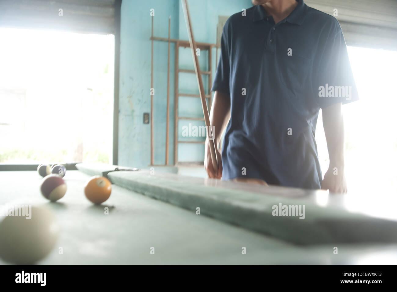 man playing billiards - Stock Image