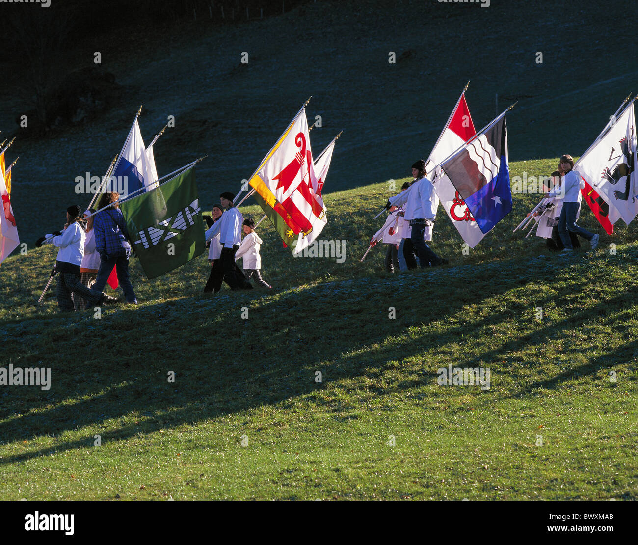 dusk twilight standard-bearer ensign commemorative celebration anniversary youngsters cantons battle fight - Stock Image