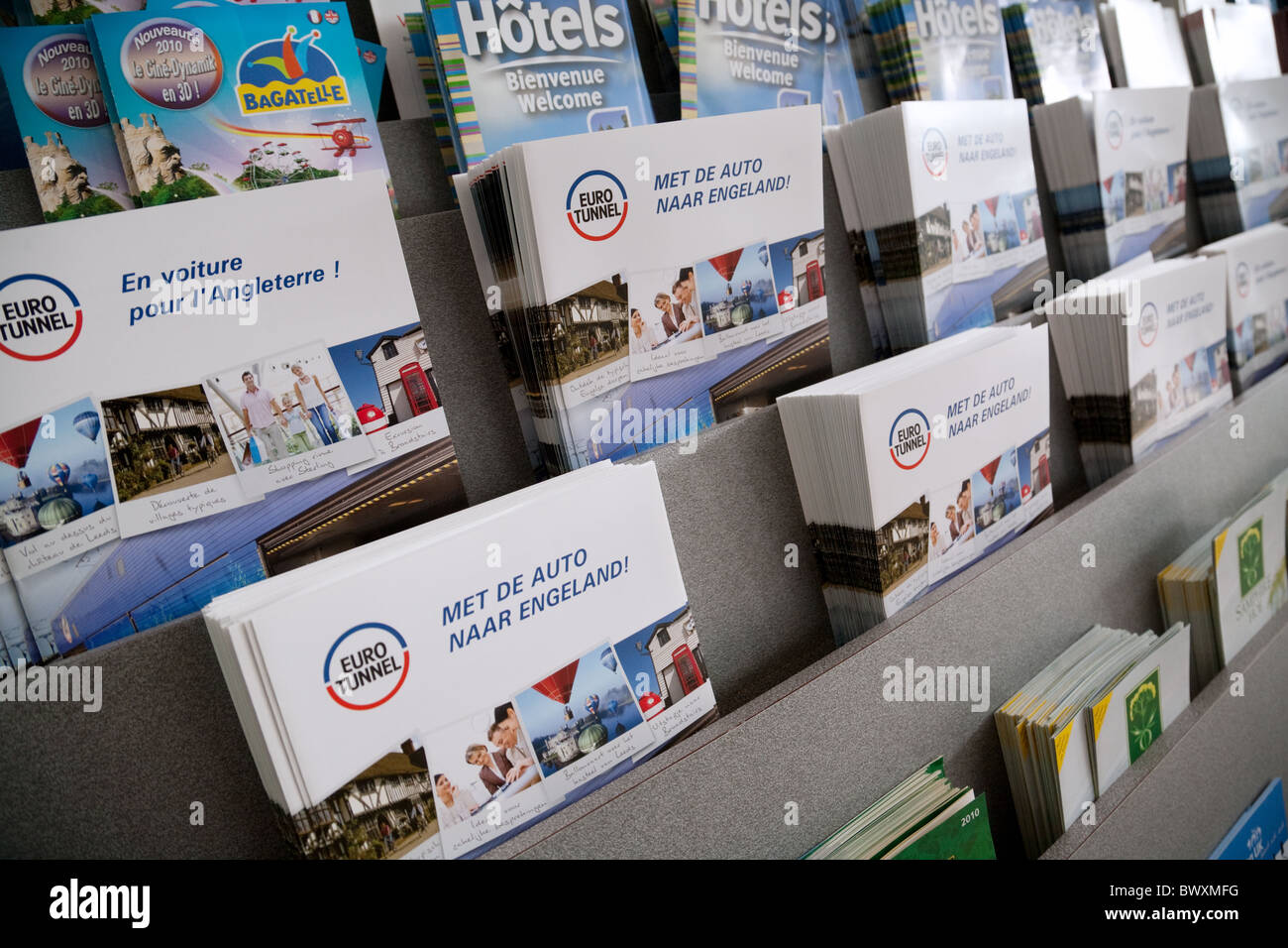Eurotunnel leaflets in different european languages at the French terminal, Eurotunnel, Calais France - Stock Image