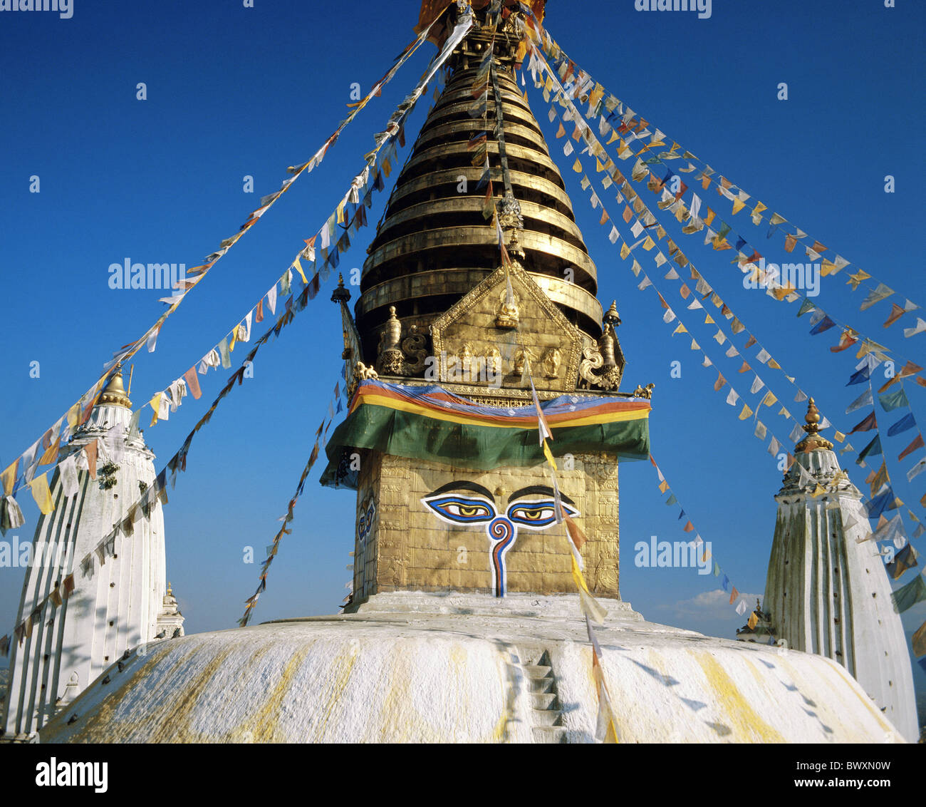 eyes flags holy site place Katmandu Nepal Asia Stupa Swayambunath tower rook - Stock Image
