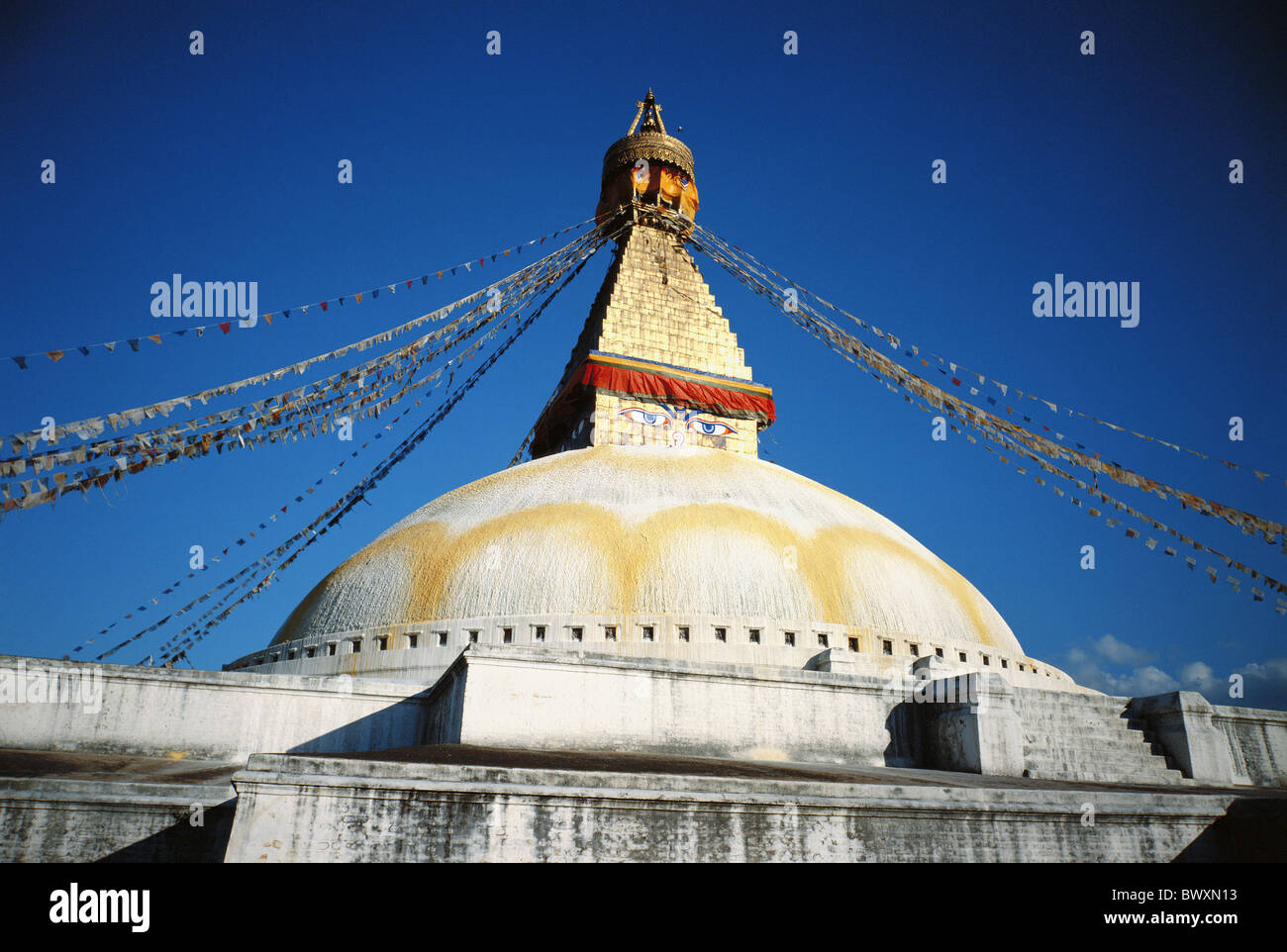 Bodnath flags holy site place Katmandu Nepal Asia Stupa temple - Stock Image