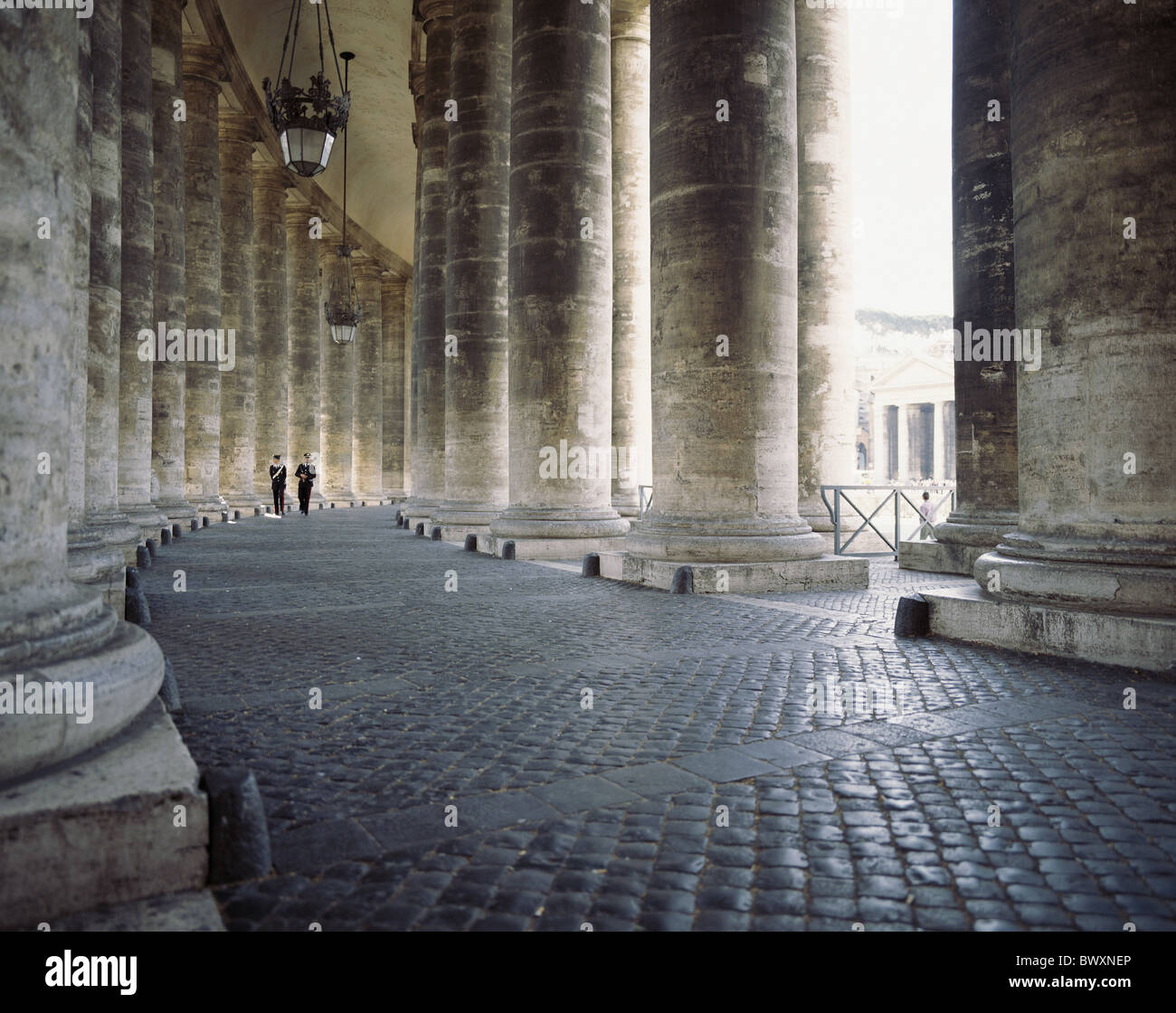 Italy Europe colonades Peter's place columns Vatican two policeman police officer - Stock Image