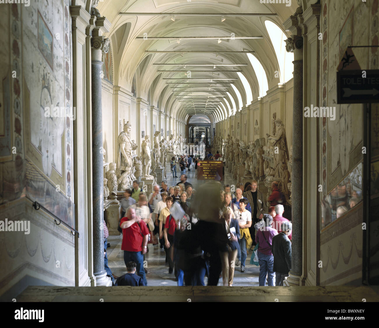 visitor inside Italy Europe museum Roman Ancient world antiquity stone sculptures Vatican - Stock Image