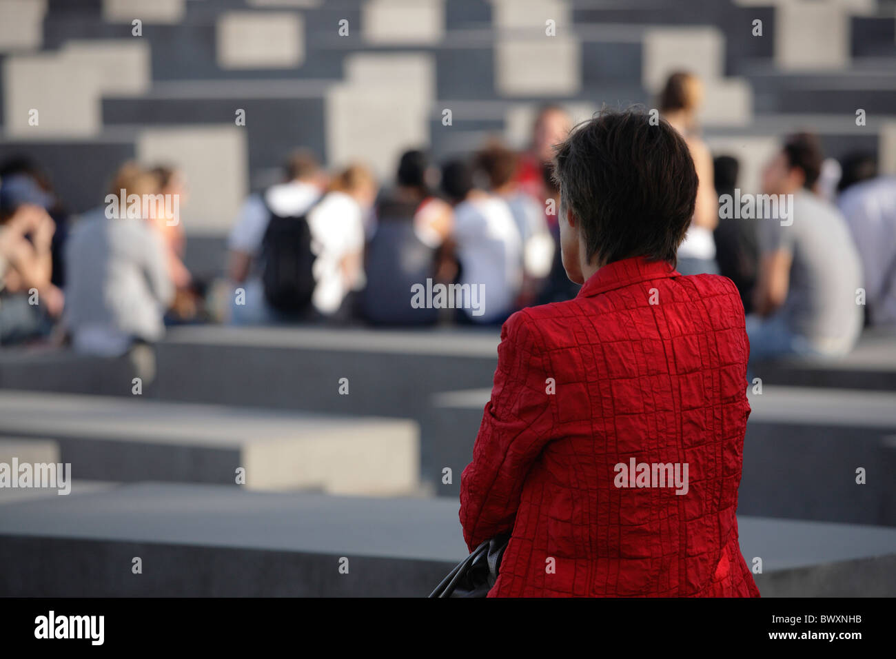 woman at the Memorial to the Murdered Jews of Europe in Berlin, Germany; Denkmal für die ermordeten Juden Europas - Stock Image