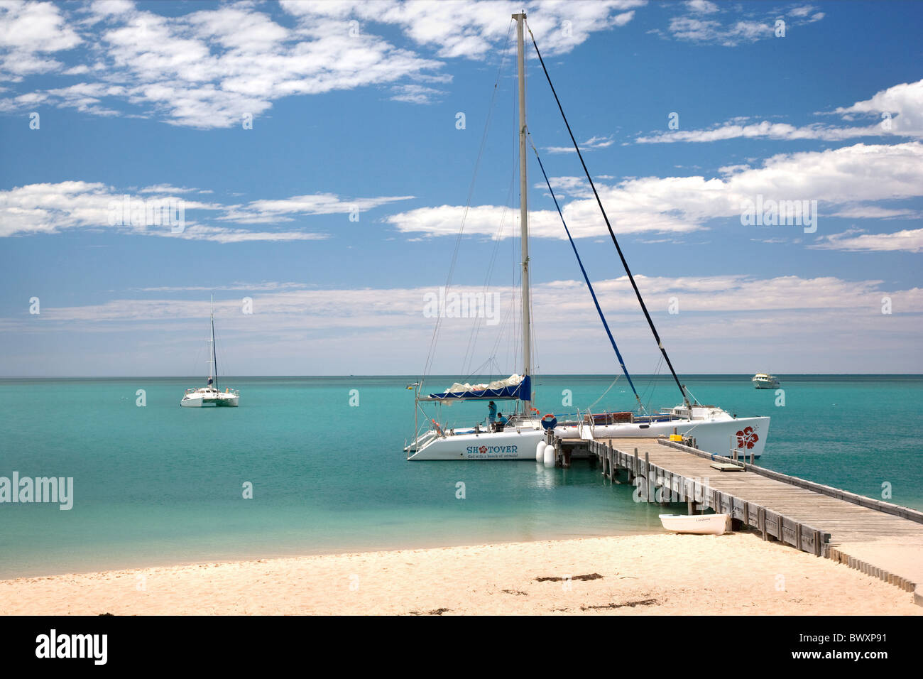 Catamaran moored at the jetty in Monkey Mia on Shark Bay Western Australia - Stock Image