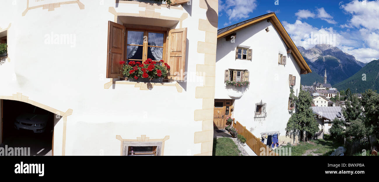 Switzerland Europe Graubunden Grisons Sent Lower Engadine village houses homes background church mountains - Stock Image