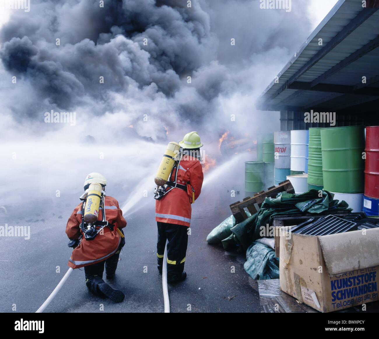 fire fire brigade department firefighters camps warehouses extinguishing smoke Rheineck scales shed Switz - Stock Image