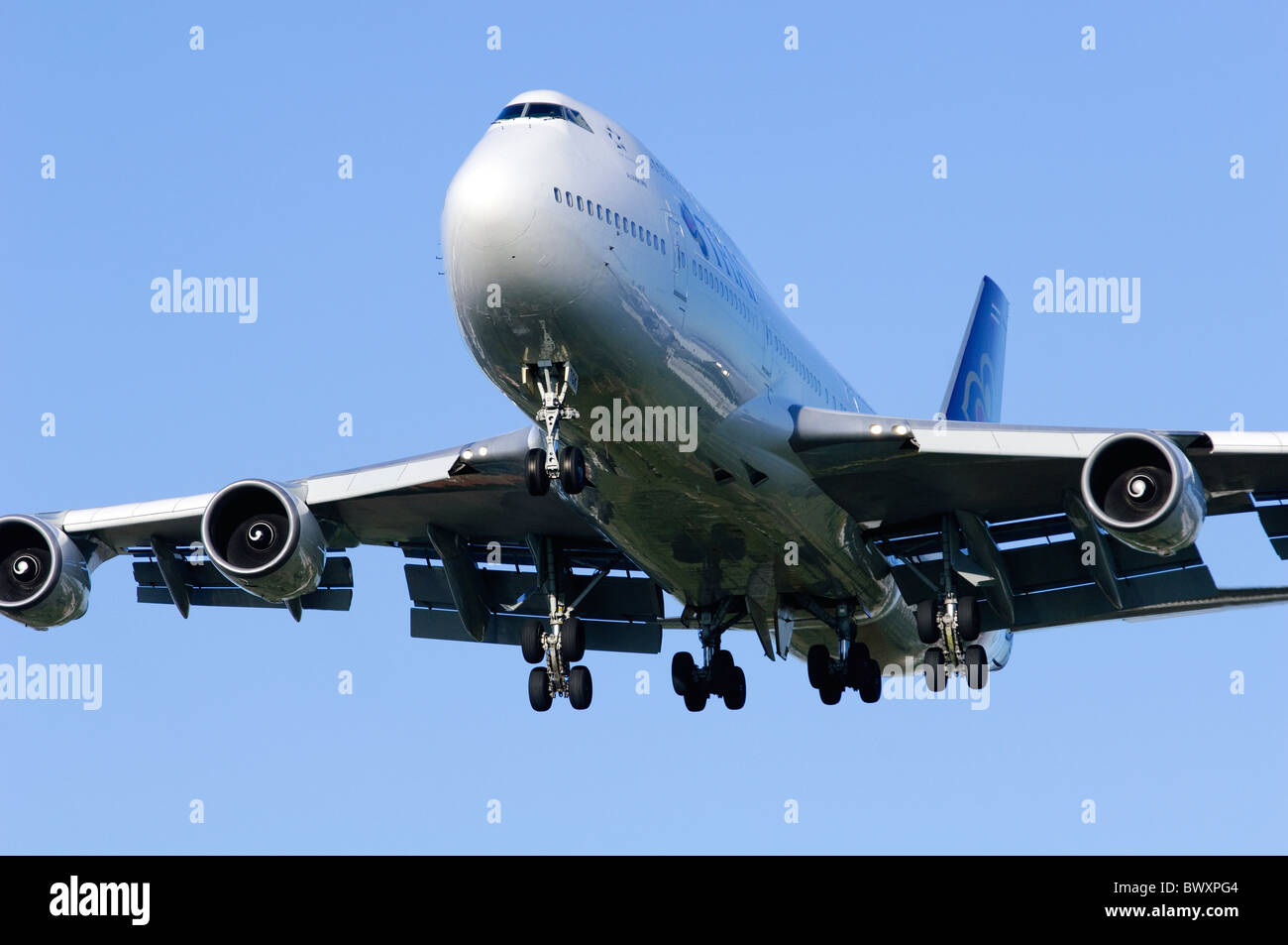 Boeing 747 jumbo jet operated by Thai Airways on approach for landing at London Heathrow Airport Stock Photo