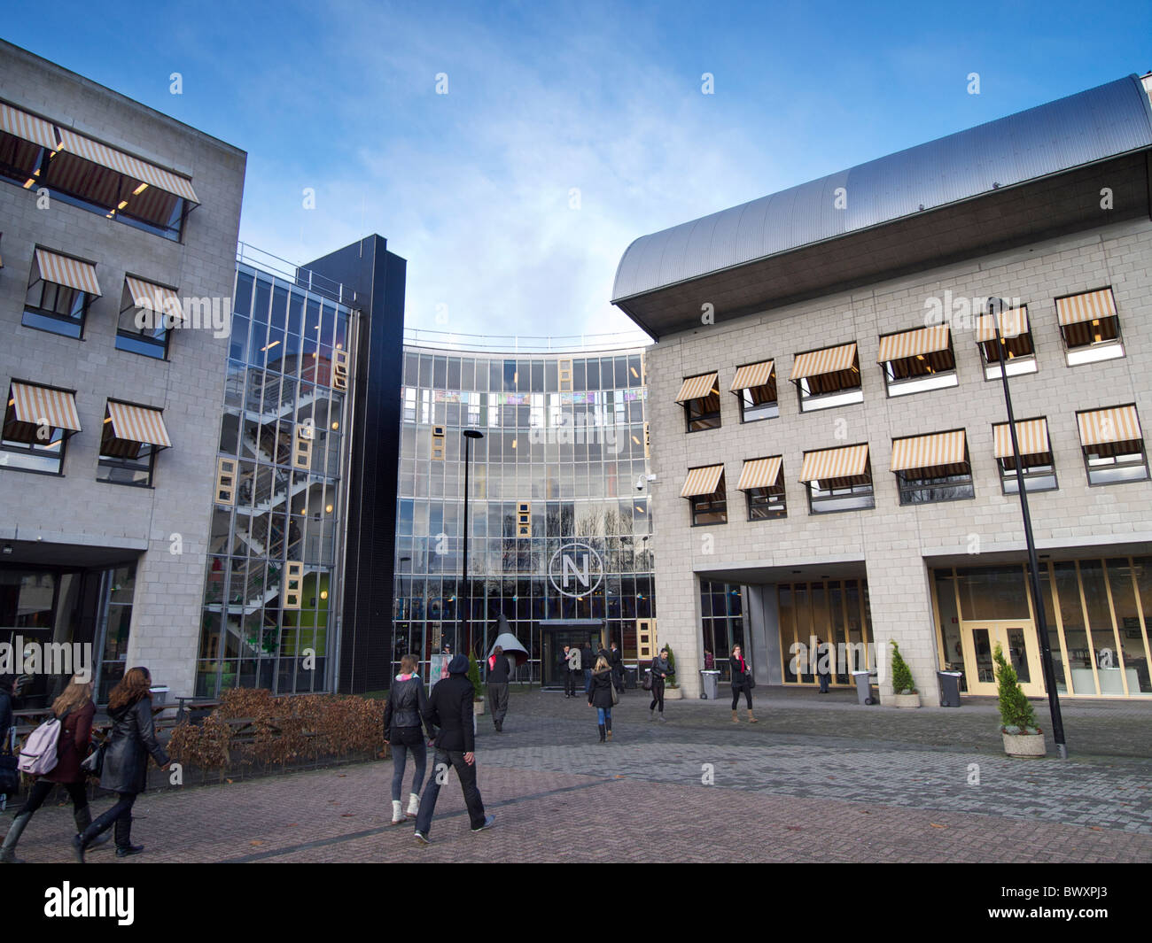 the NHTV building with students in Breda, Noord Brabant the Netherlands. Higher education for the tourism business. - Stock Image