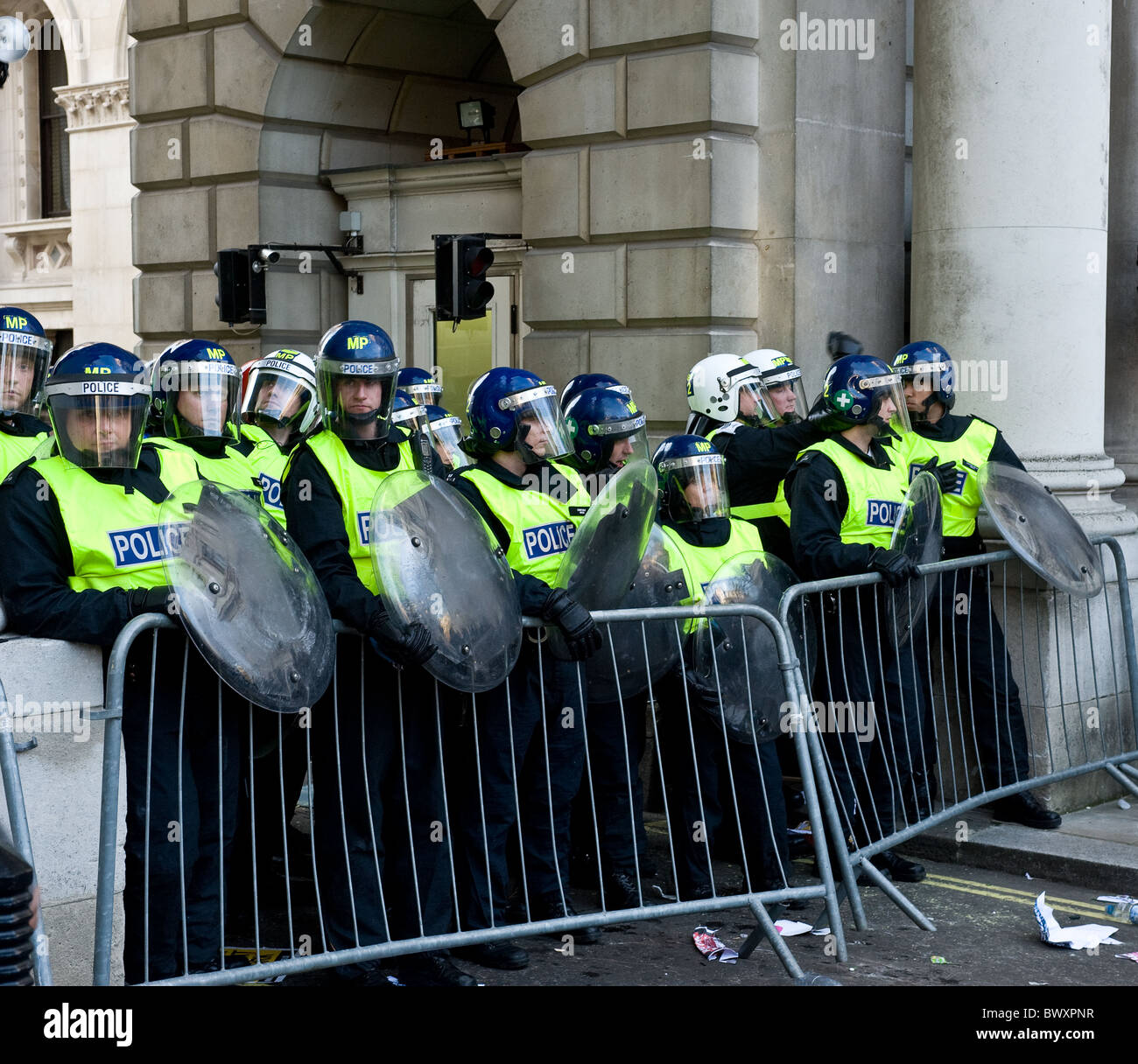 Metropolitan Police in riot gear at a demonstration in London. - Stock Image