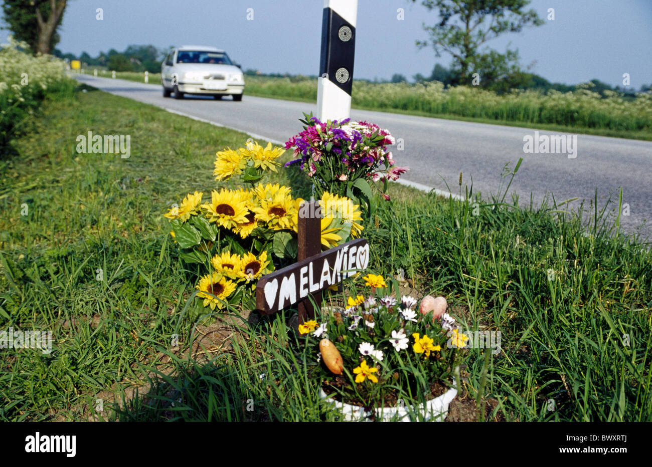 flowers commemorative site cross street edge traffic accident casualty road casualty street victim victim - Stock Image
