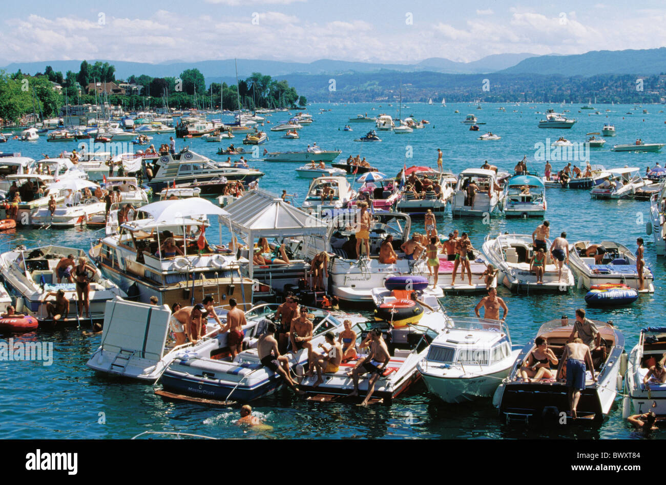 1999 boats lives people no model release party Switzerland Europe lake sea Streetparade party fête town - Stock Image