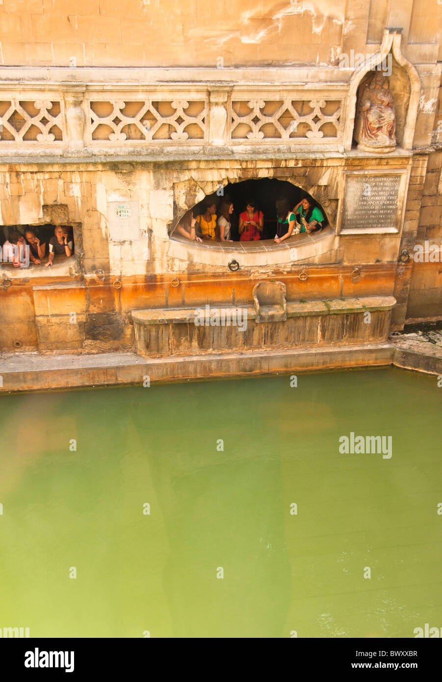 Kings Bath, Roman Baths with children looking out at the water, BATH, England UK - Stock Image