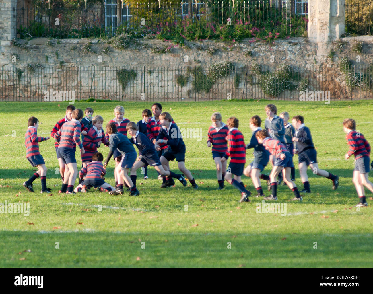 School children playing rugby on Merton college fields. Oxford. England - Stock Image