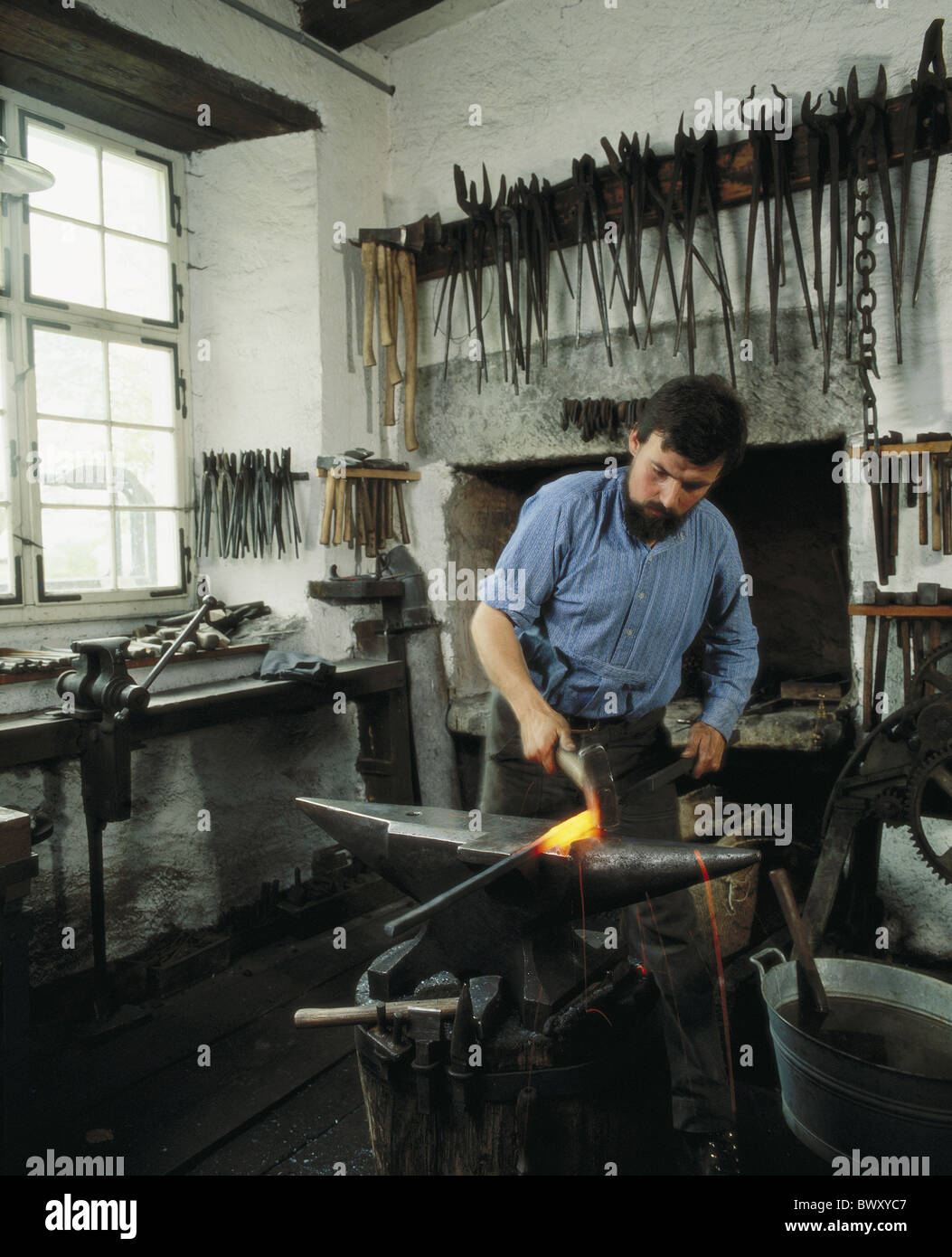 anvil iron fireplace hammer smiths metal processing smith tools - Stock Image