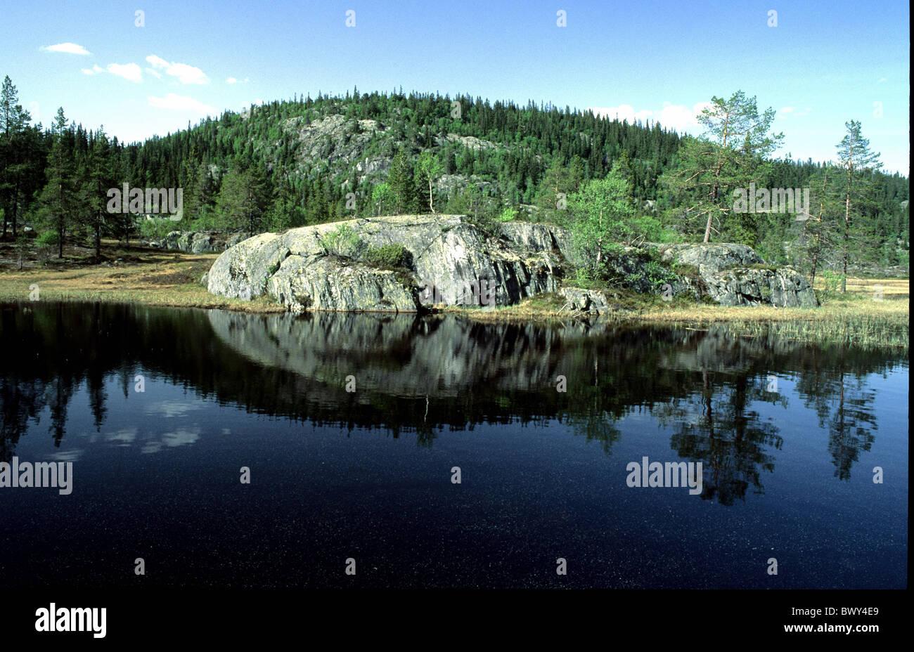 near Amot rock cliff body of water scenery Norway Europe reflection telemark Stock Photo