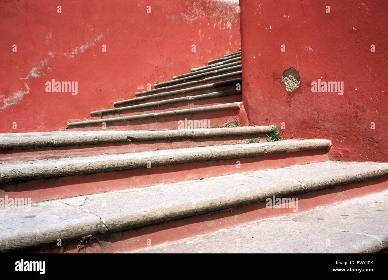 rising stairs church lane Guanajuato house home house walls Mexico red stair - Stock Image