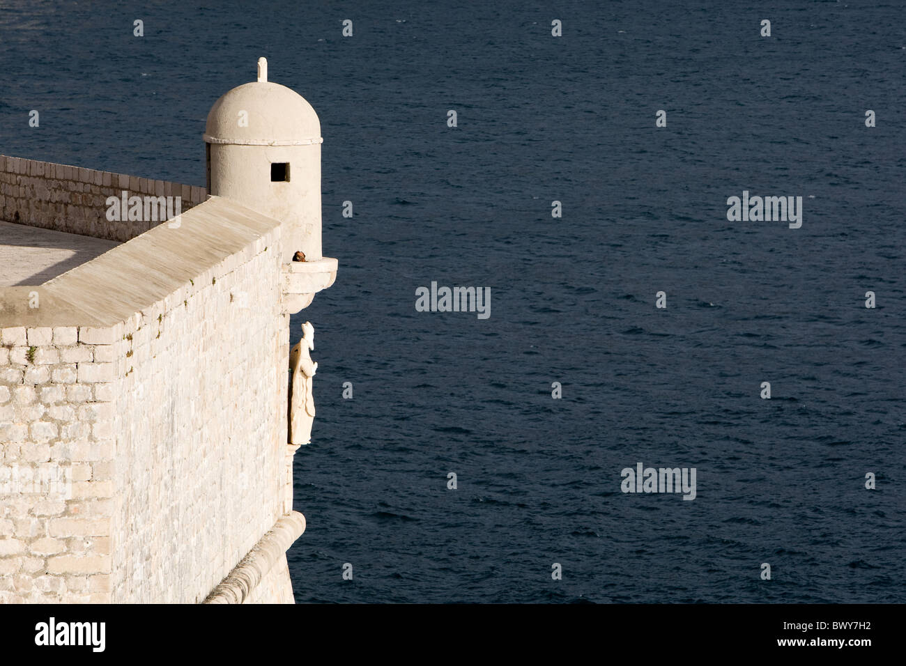 Statue of St Blaise looks over the Adriatic Sea from the Old Town walls of Dubrovnik, Croatia - Stock Image