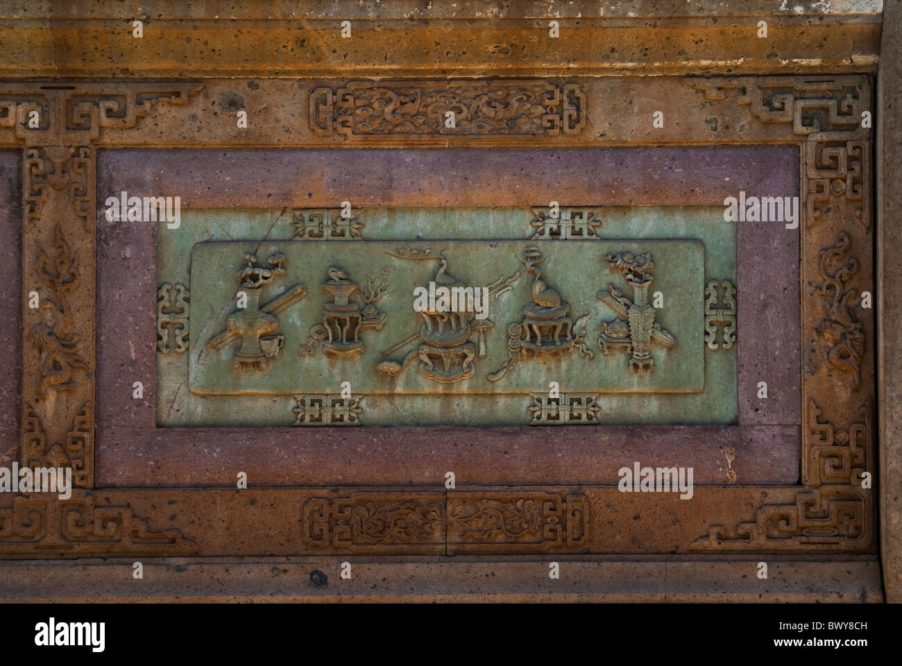 Ancient brick relief carved with scholar's treasures in Chenghuang Temple, Xishan No.1 Building, Shengzhou, - Stock Image