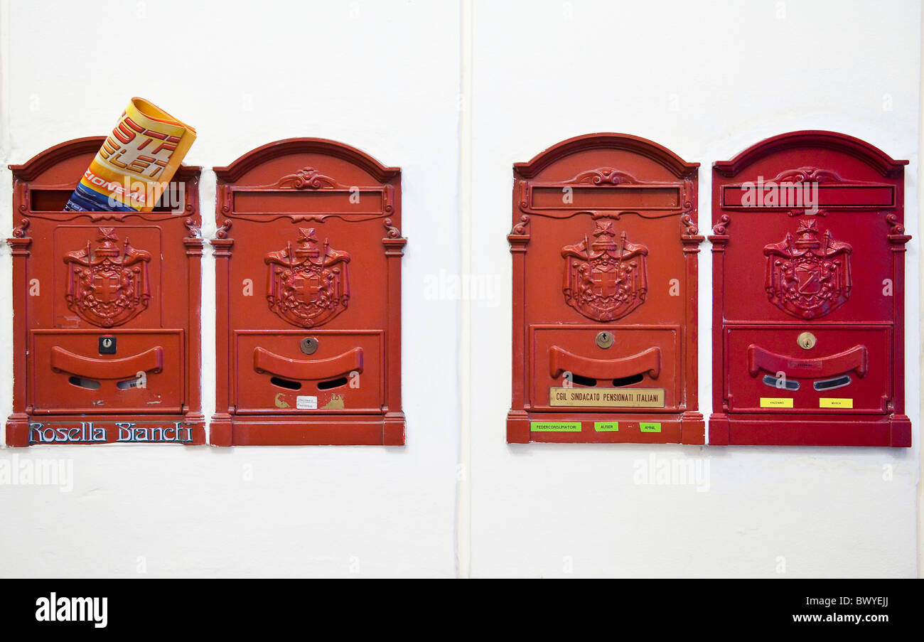 Four mailboxes in an Italian apartment block - Stock Image