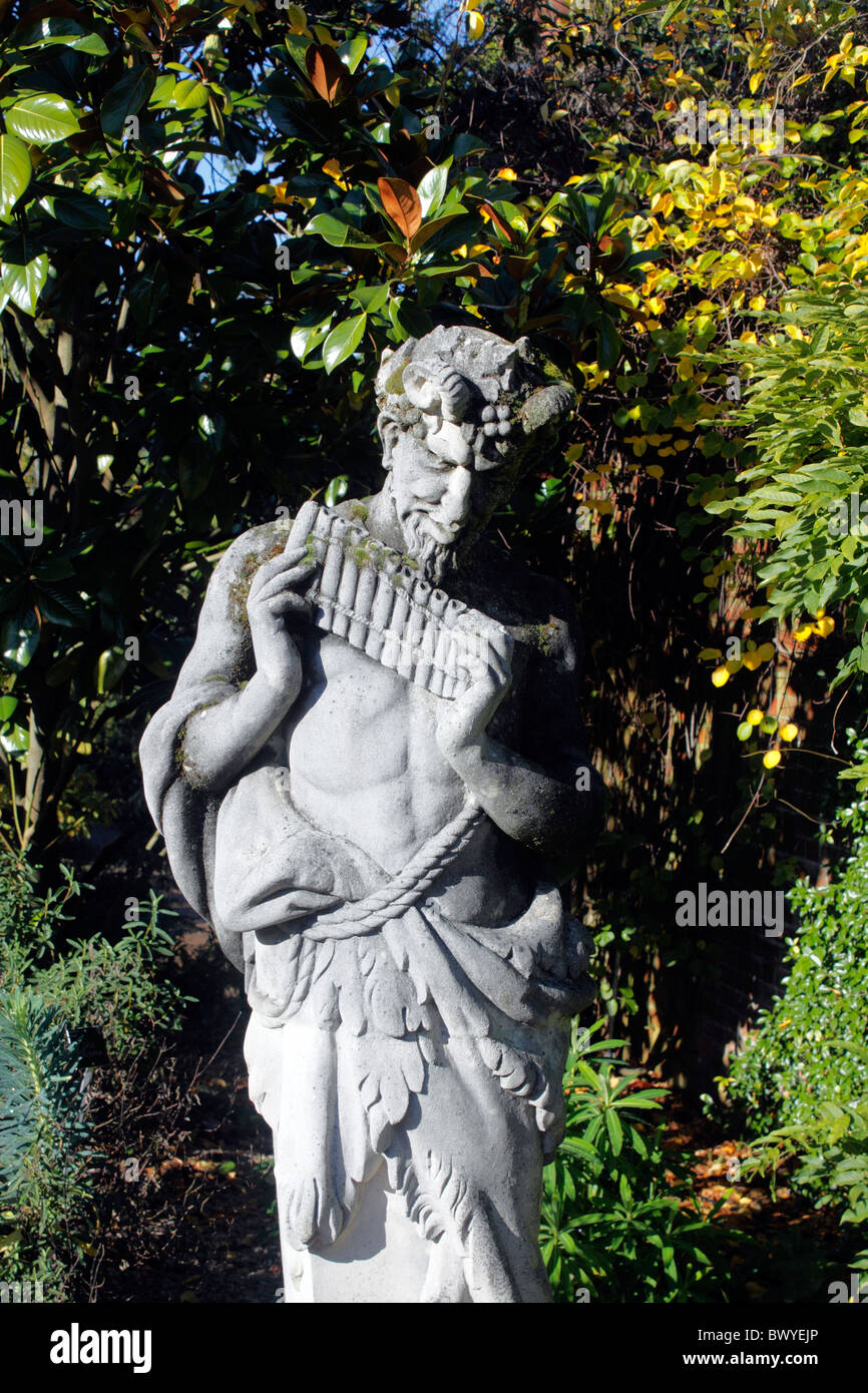 A GARDEN STATUE OF PAN THE GREEK GOD OF SHEPHERDS AND MUSIC. RHS WISLEY UK.