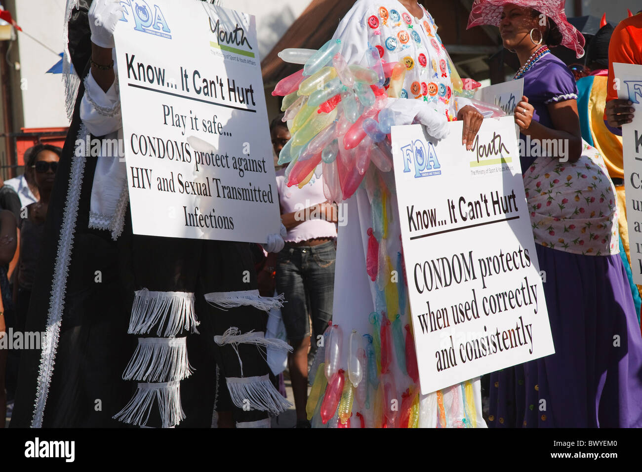 Traditional Mas parade, Ole mas social awareness for HIV aids - Stock Image