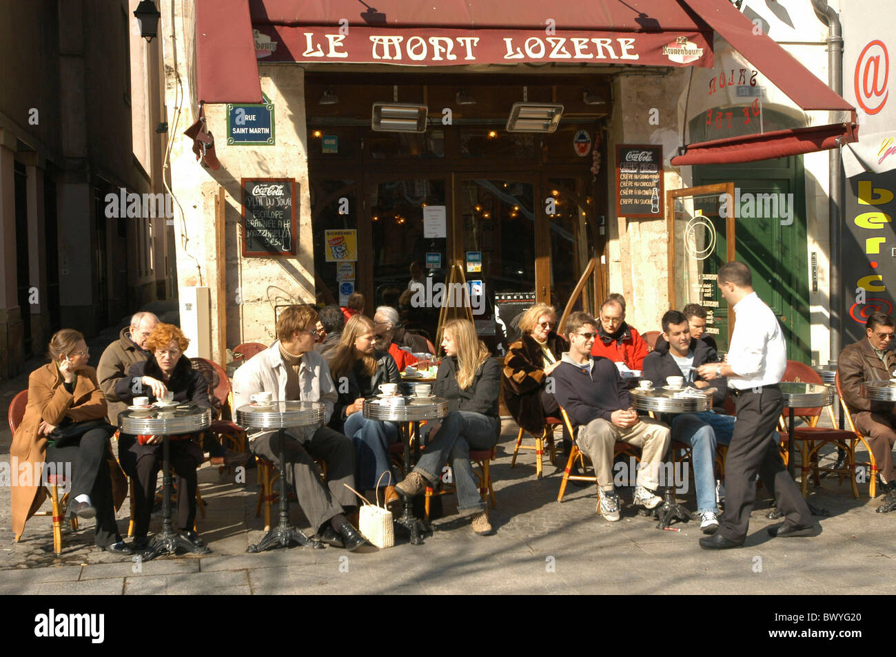 outside cafe France Europe guests company lives no model release Paris street cafe - Stock Image