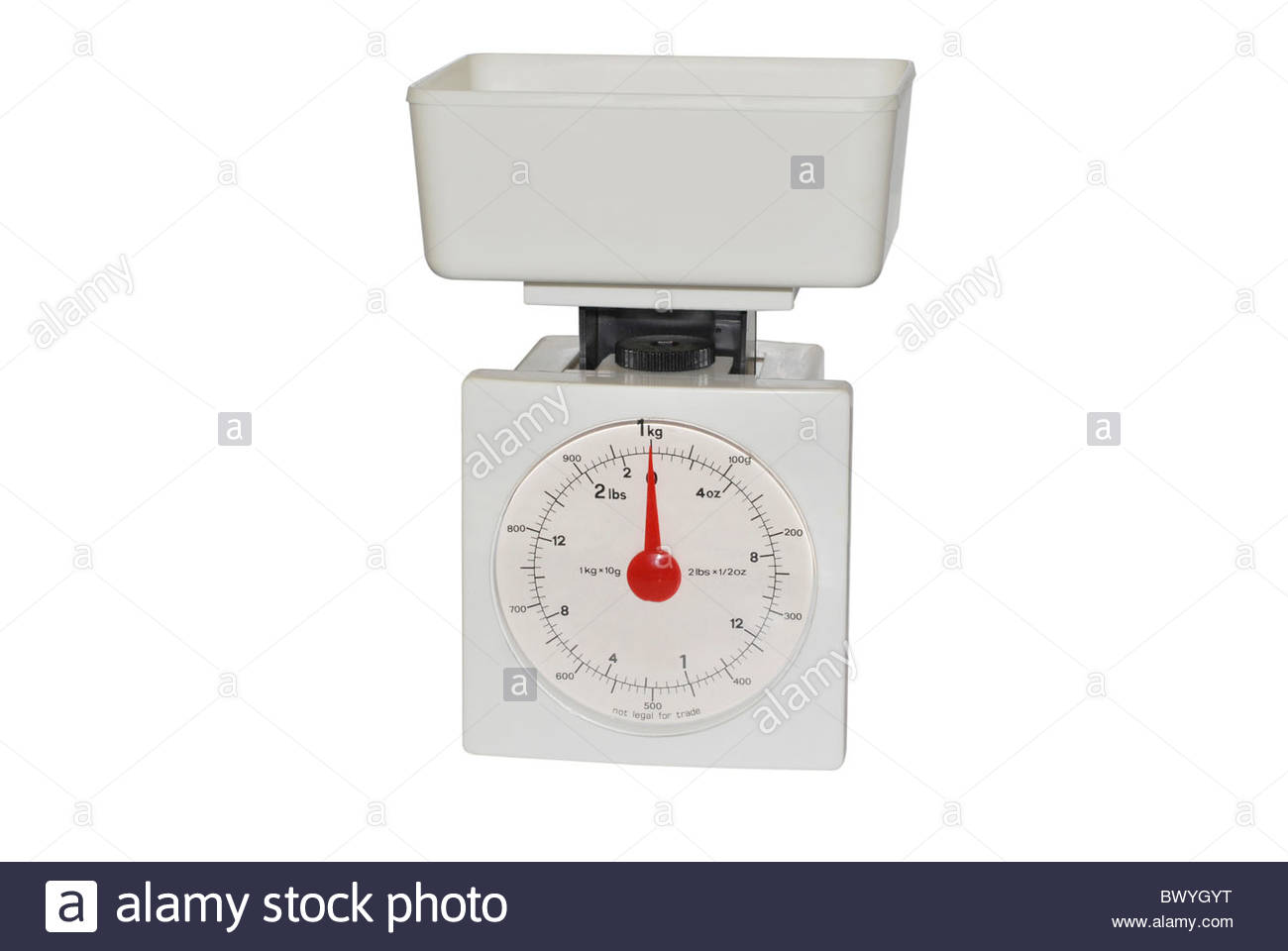 Plastic kitchen scale isolated over white. Weight measurement intrument - Stock Image