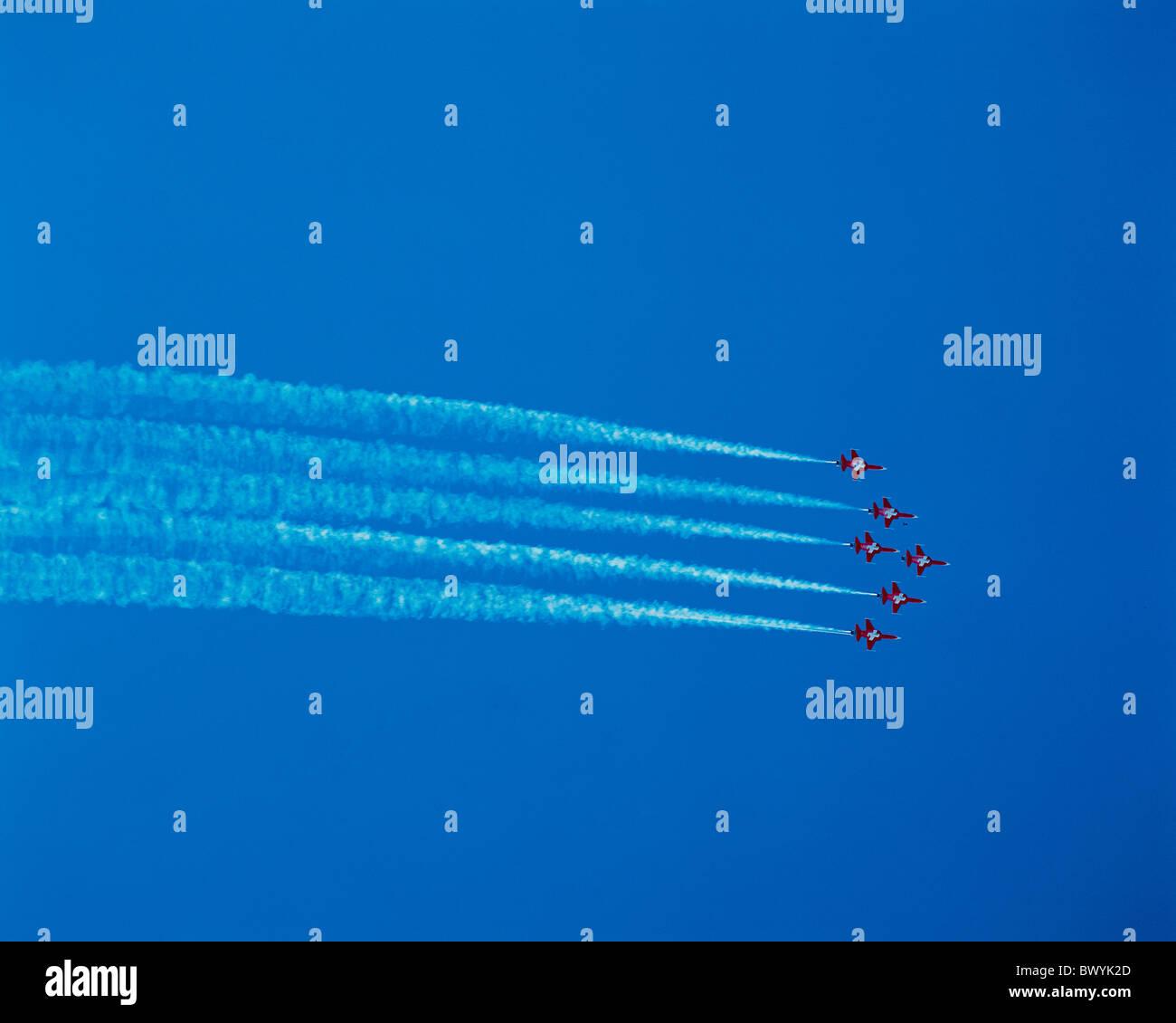 jet jet airplane formation flight patrol Suisse airman plane relay blue sky Switzerland Europe Bern airpla - Stock Image