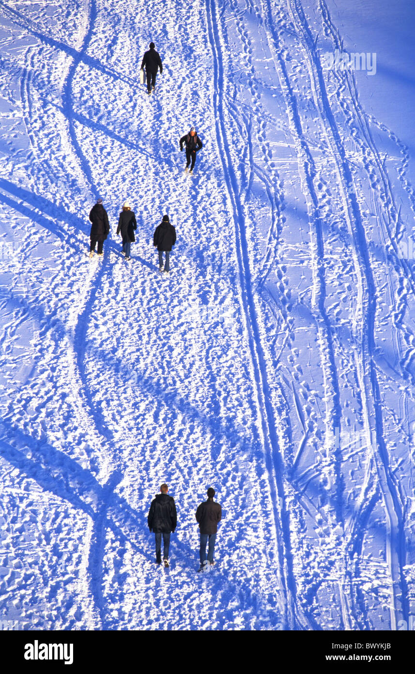 pedestrian froze go people painting ares people no model release pedestrians snow Sweden Europe lake sea - Stock Image