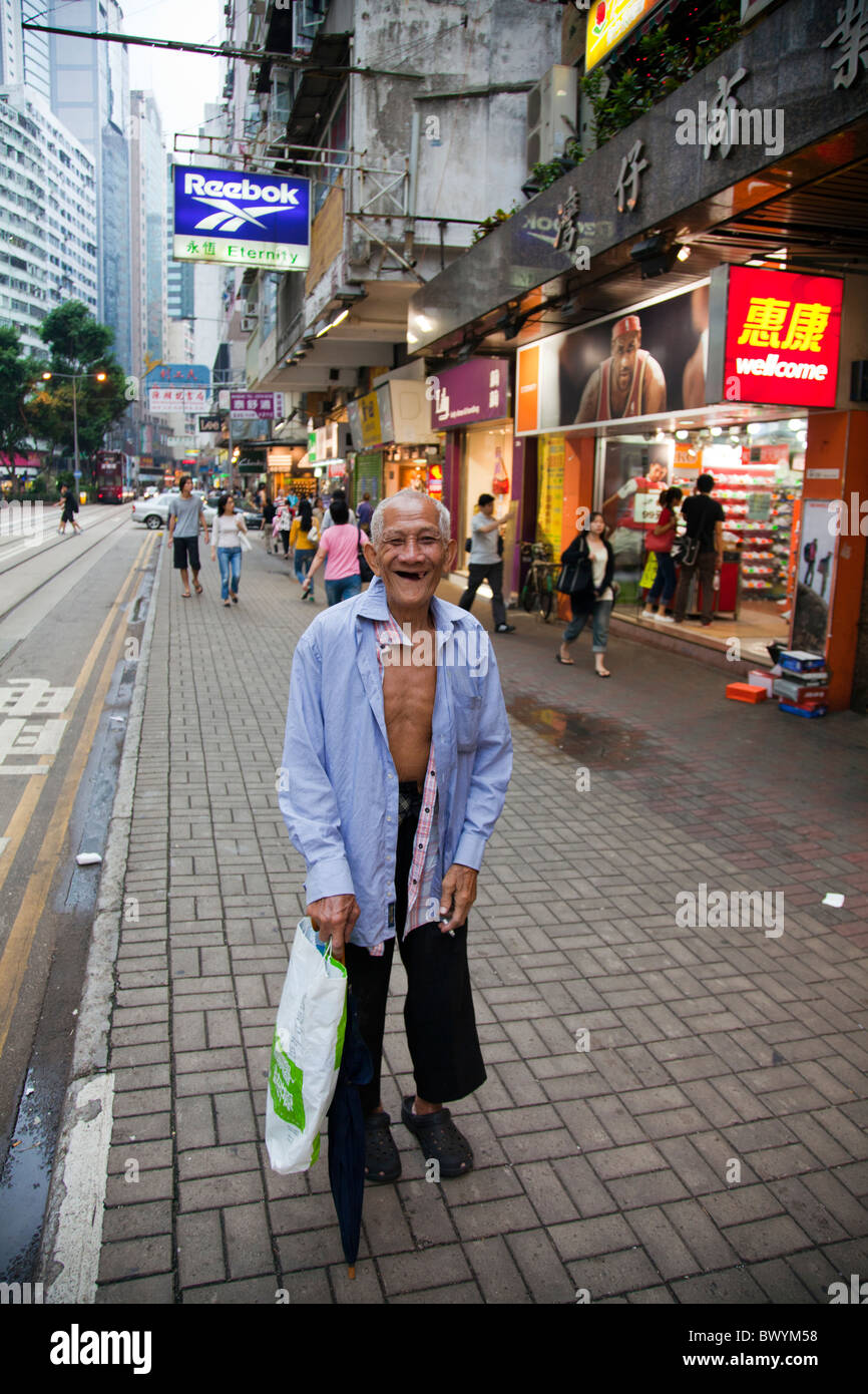 A Hong Kong beggar, tramp, vagrant, roaming the  streets looking for handouts - Stock Image