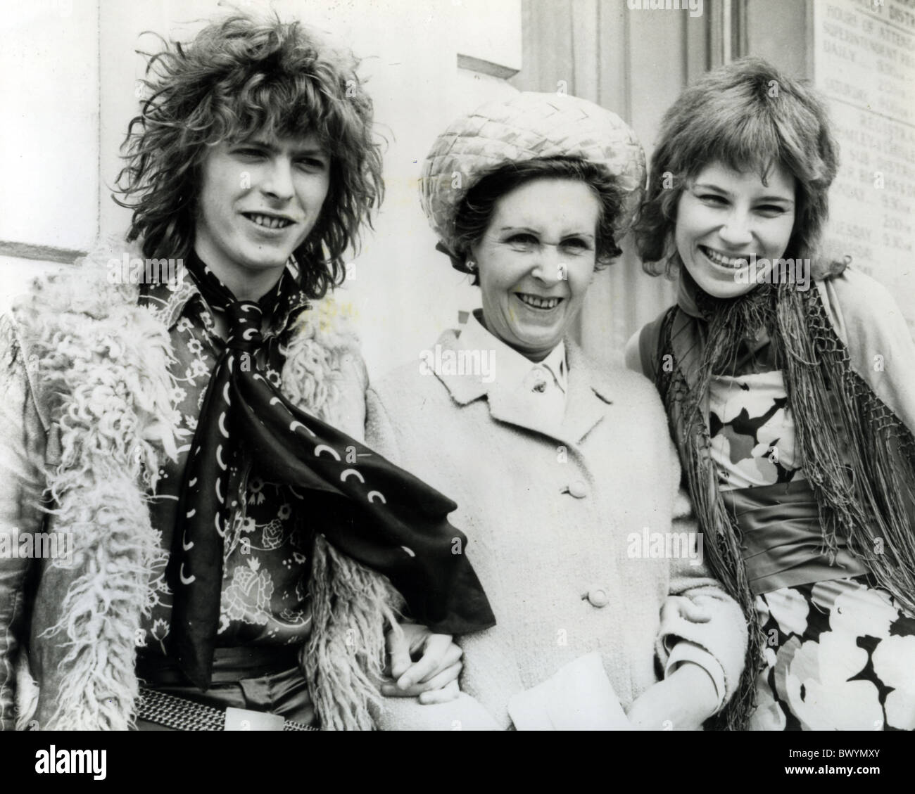 DAVID BOWIE outside Bromley Registry office on 20 March 1970 after marrying Angie Barnett seen here with her mother - Stock Image