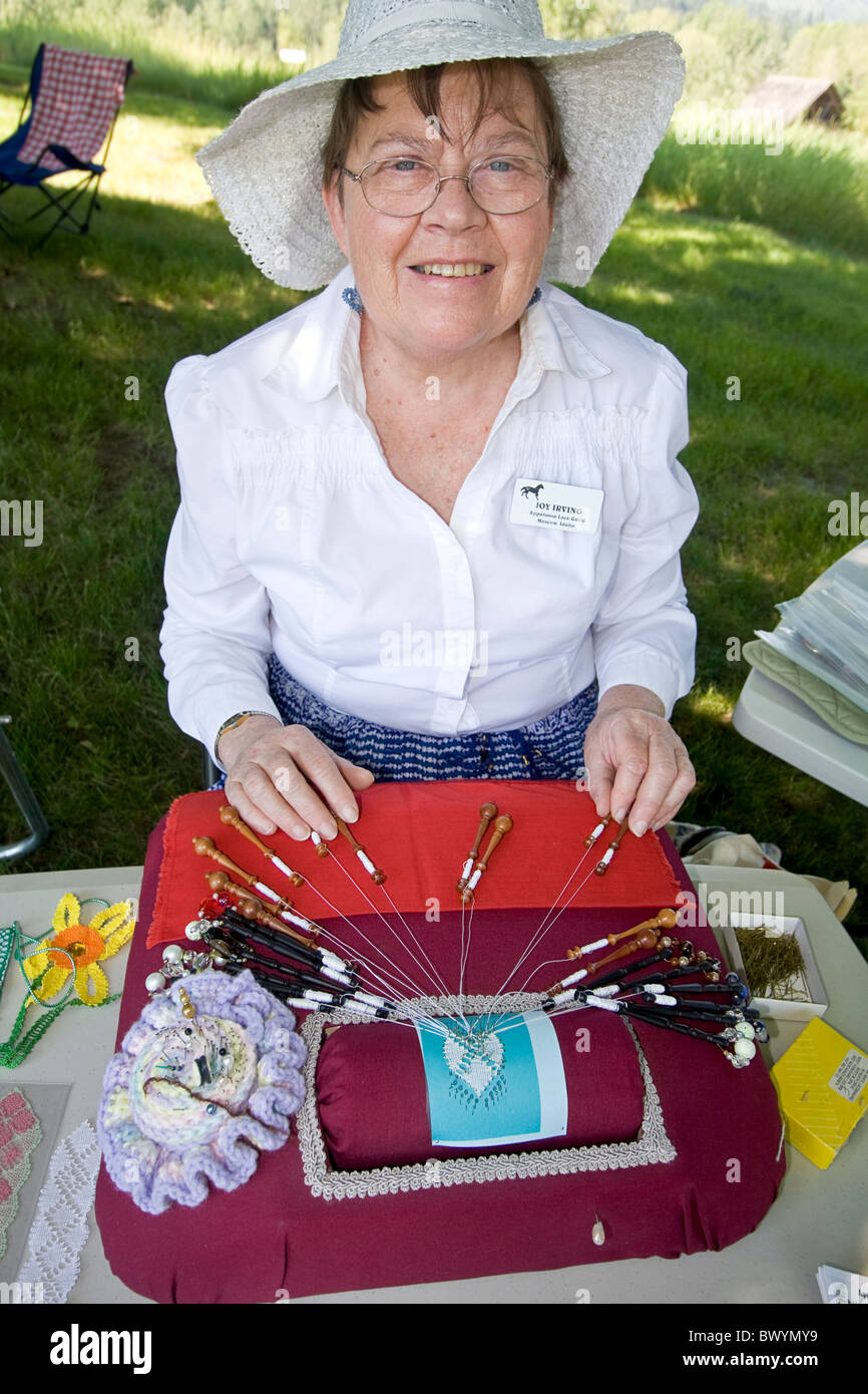 Woman shows how to make bobbin lace at Living History fair on the grounds of Old Mission State Park in Cataldo, - Stock Image