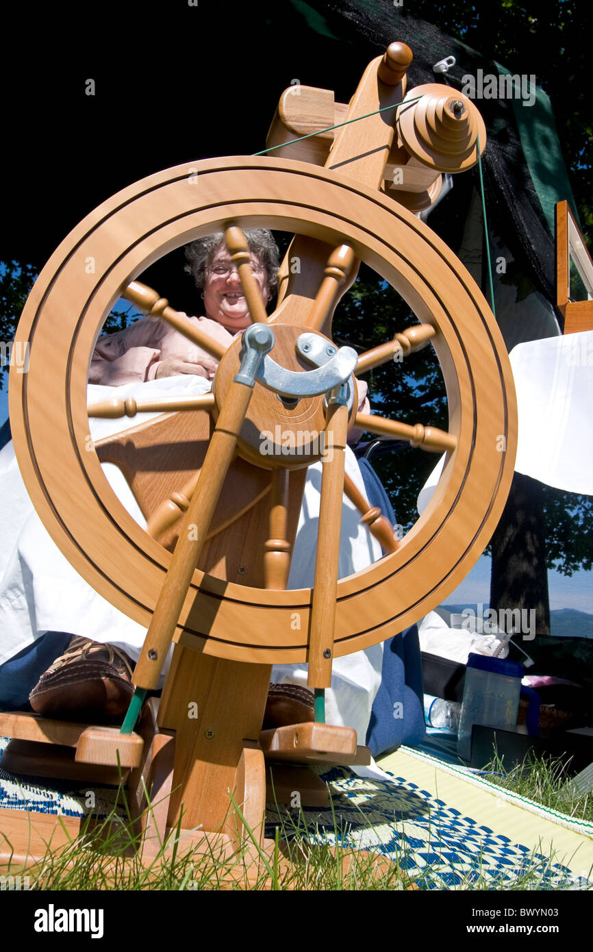 Woman demonstrates how to spin wool at Living History fair on the grounds of Old Mission State Park in Cataldo, - Stock Image
