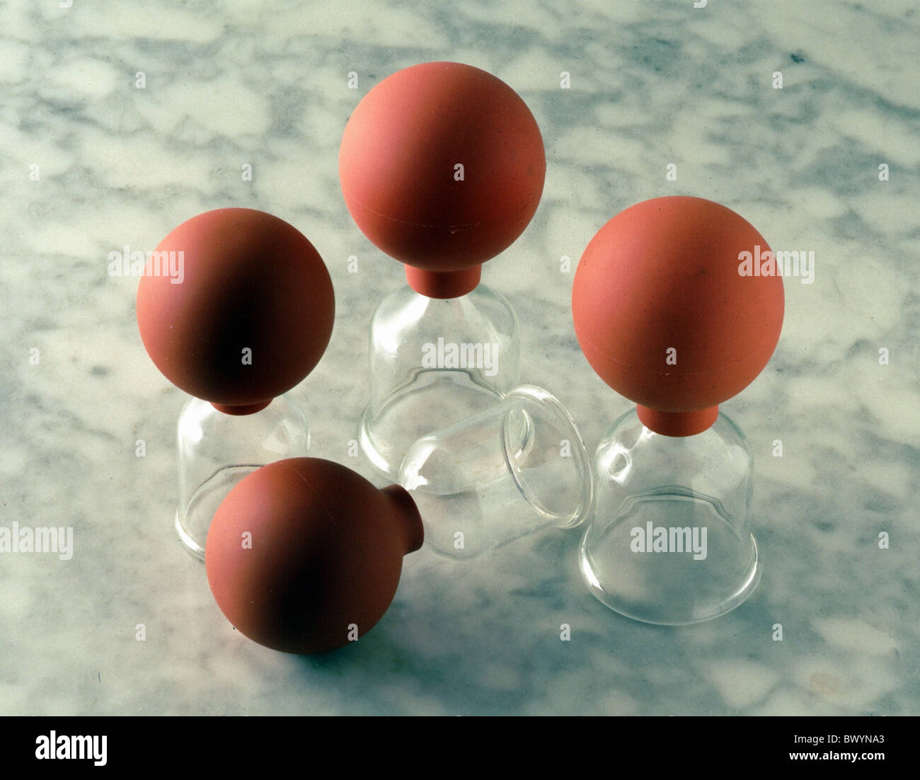 alternative medicine fleecing health medicine cupping exsanguinate suction glasses - Stock Image