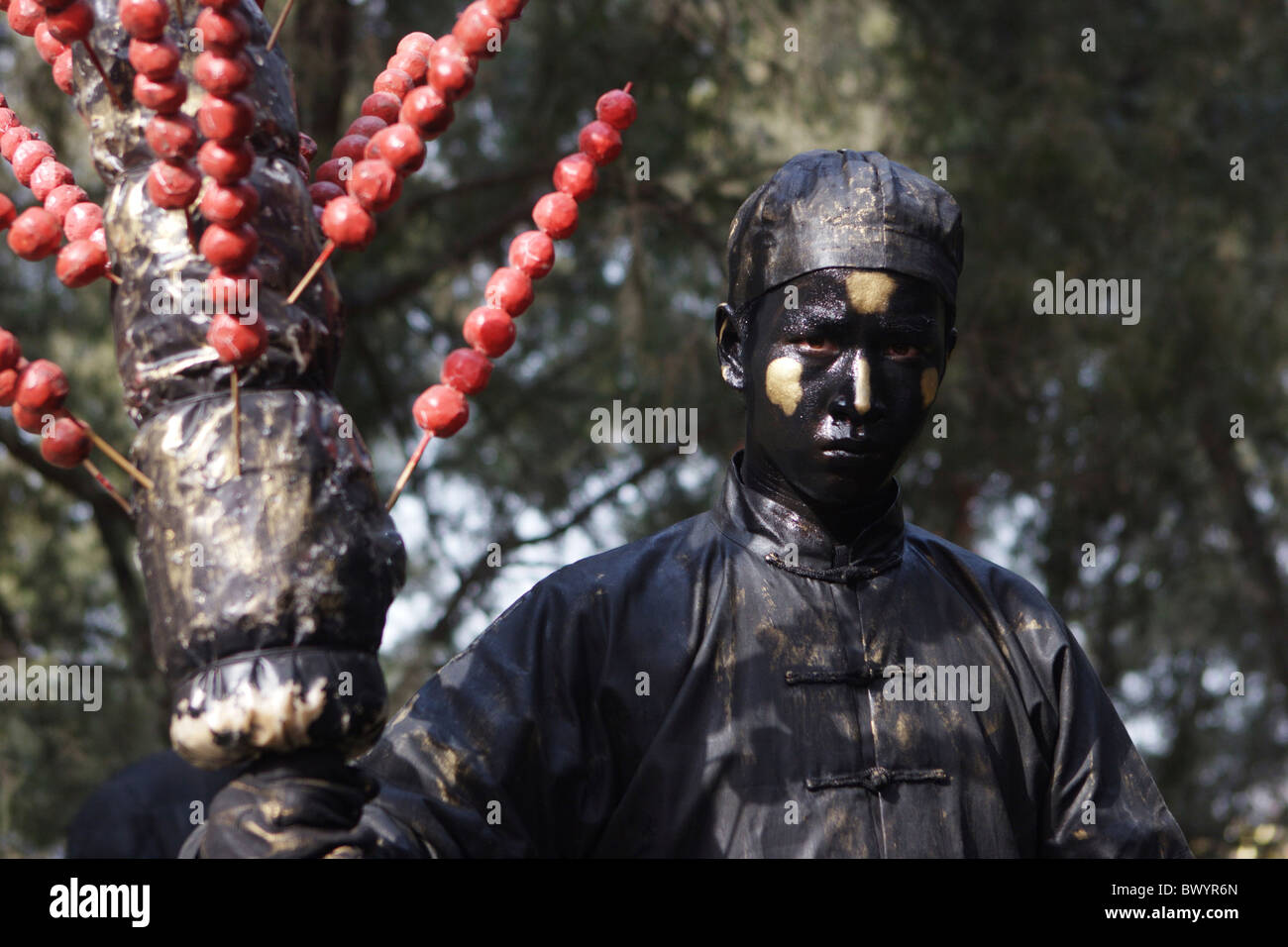 A mime performing during Ditan Temple Fair, Spring Festival, Beijing, China - Stock Image