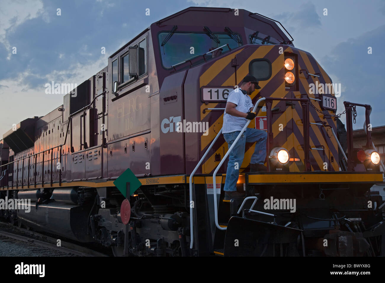 Alamosa, Colorado - A worker climbs onto a locomotive of the Rio Grande Scenic Railroad at the station in Alamosa. - Stock Image