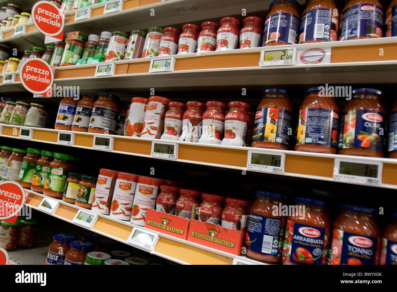 stock stack large group tomato sauce tins in Store supermarket market shopping buying food Rome Italy Italian offer - Stock Image