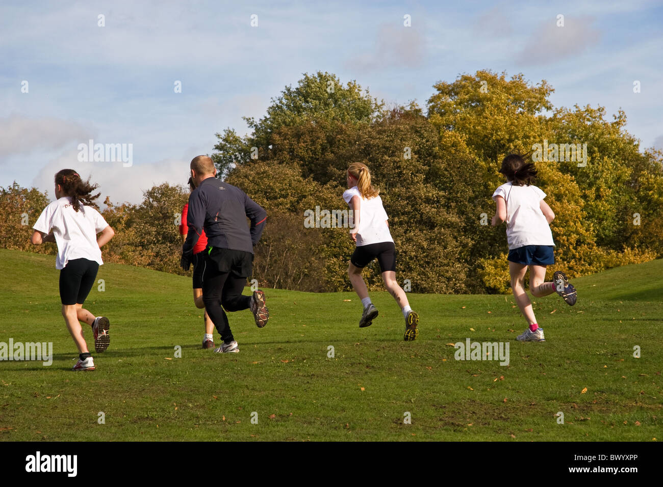 Young athletes and trainer, Heaton Park, Manchester, UK - Stock Image