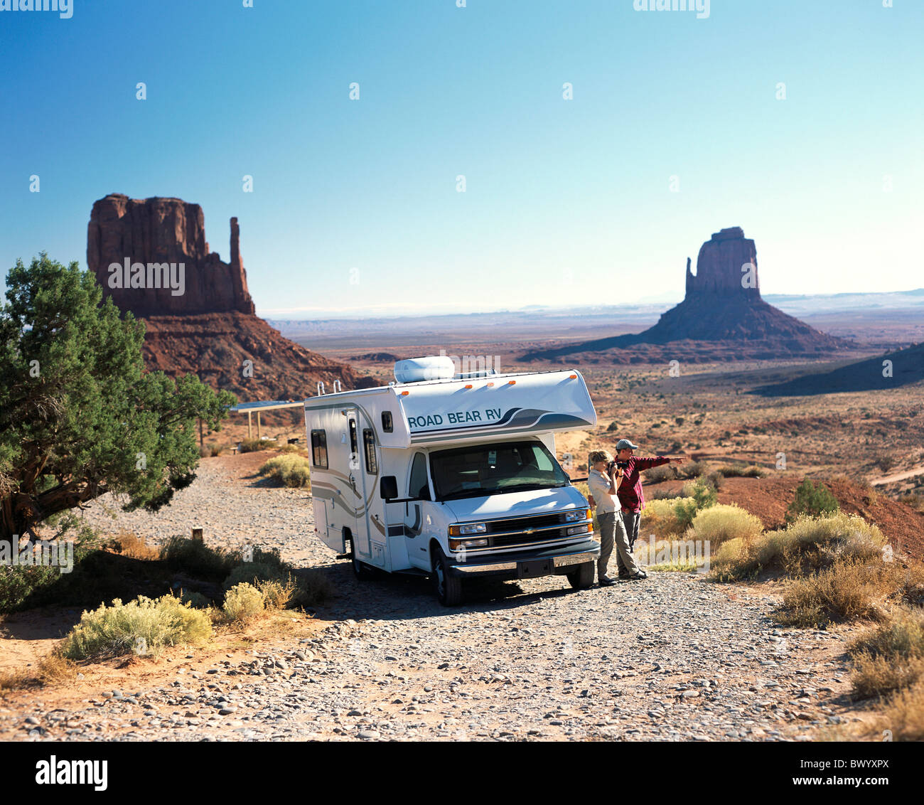 holidays vacation Arizona camping take photos scenery monument Valley pair couple USA America North Ameri - Stock Image