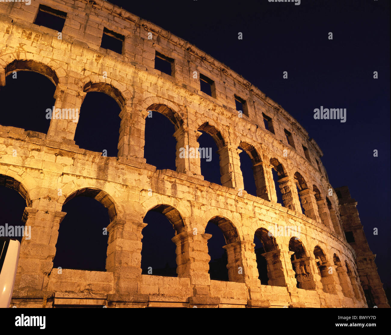 amphitheater Ancient world antiquity arcades detail facade historical Istria Croatia night at night Roman - Stock Image
